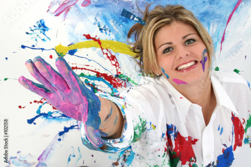 beautiful young woman covered in paint