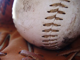 close up of baseball and ball glove poster