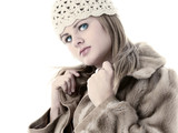 beautiful young woman in hat and fur winter coat poster