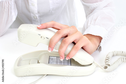 manicured hand on telephone