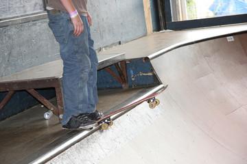 teen skateboarder dropping in