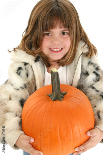 beautiful five year old girl with pumpkin t-shirt