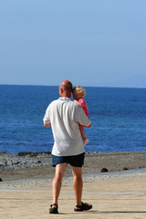 a child in daddys arms