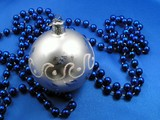 silver ball and blue beads poster