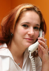 receptionist answering her company's phone