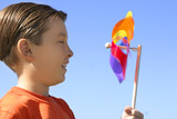 boy with a spinning wheel pinwheel poster