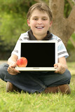 child holding laptop poster