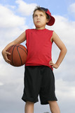 standing child holding a basketball poster