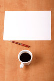 blank paper, cup of coffee and pen poster
