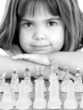 beautiful little girl with glass chess board poster