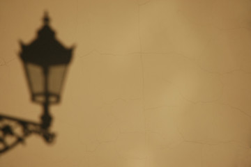 shadow of the lamp on wall