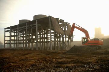 dismantling ruin by digger