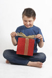 sitting child opening a present poster
