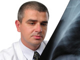 doctor analizing a chest radiography poster