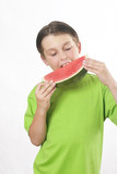 boy eating a piece of watermelon poster