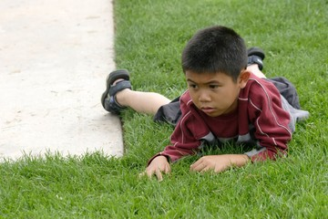 boy resting on the grass
