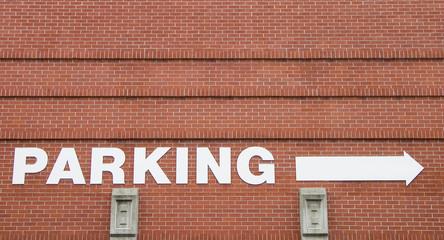parking arrow on a wall.
