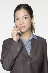 female asian business executive on phone