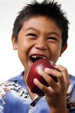 boy with missing front teeth about to bite an appl poster
