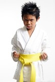 karate kid with yellow belt poster