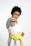 boy with yellow belt practicing karate poster