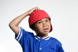 confused kid in red baseball cap poster