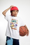 little boy scratching his head holding a basketbal poster