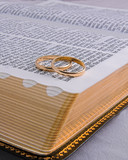 gold rings & corner of bible poster