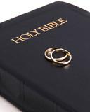 bible & wedding rings on top poster