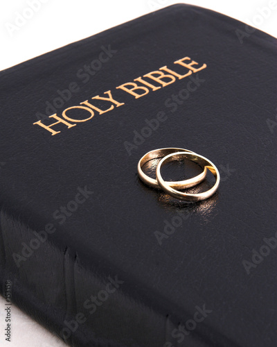 poster of bible & wedding rings on top