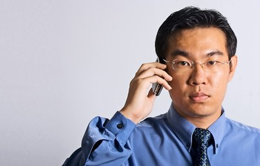 asian businessman with phone