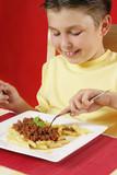 child eating pasta poster