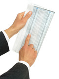 hands holding newspaper with stock reports poster