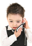 stock photography: toddler boy in suit on cellphon poster