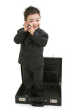 stock photography: toddler boy in suit standing in poster