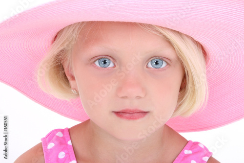 beautiful little girl in pink swim suit and large