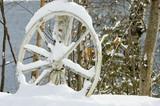 abandoned wagon wheel close up poster