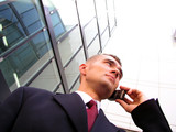 businessman using a mobile phone poster