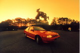 red auto at sunset poster