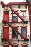white n red building stairs poster