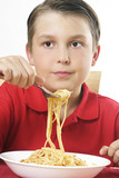 child with forkful of noodles poster