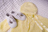 baby shoes and suit poster