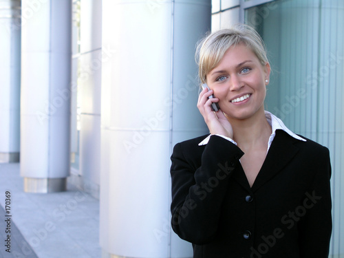 poster of businesswoman using a mobile phone