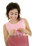 young woman looking into shopping bag poster