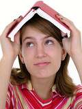 girl holding book on head poster