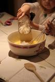 un enfant prepare  la pate la crepe poster