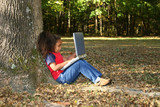 child outside with laptop poster