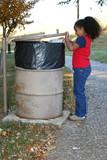 child throwing away trash poster