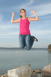 happy teen girl jumping poster