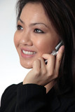 close--up of attractive business woman talking on cell phone poster